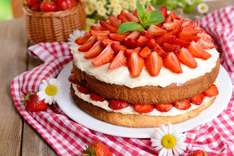 delicious-biscuit-cake-with-strawberries-on-table-close-up-4