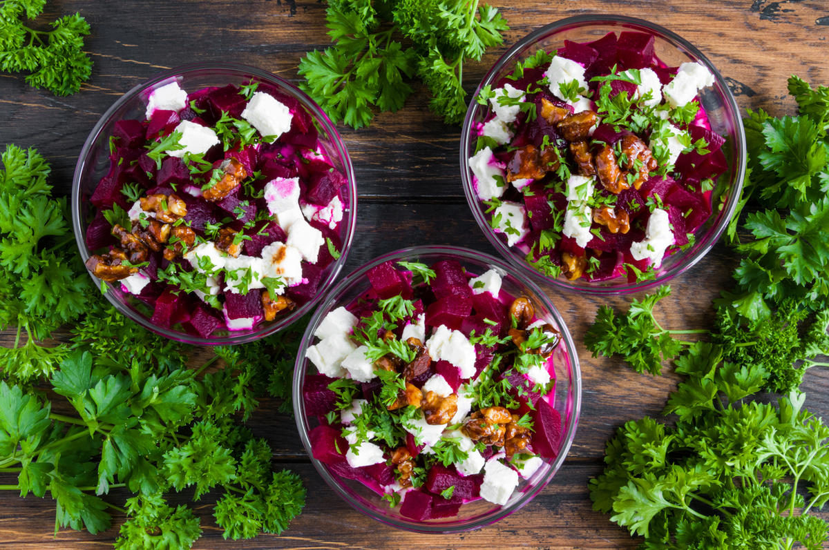 vegetarian-salad-with-baked-beet-greek-yogurt-fresh-parsley-walnuts-and-feta-cheese-in-small-glass-bowls-on-the-rustic-wooden-table-top-view