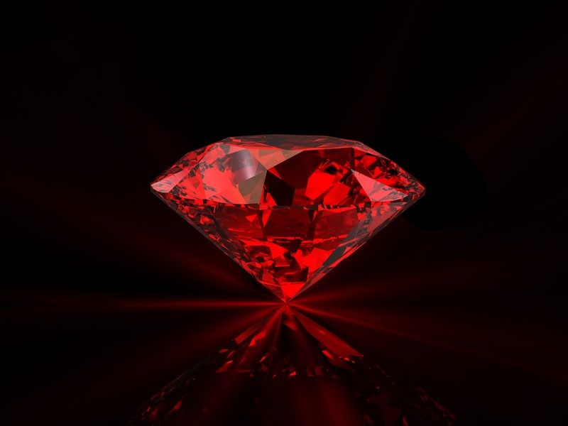 shiny-red-diamond-on-reflective-black-background-2