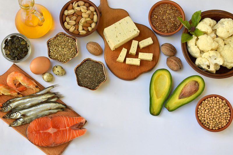 composition-of-products-containing-unsaturated-fatty-acids-omega-3-fish-nuts-tofu-avocado-egg-soybean-flax-pumpkin-seeds-chia-hemp-cauliflower-dill-vegetable-oil-top-view-healthy-food