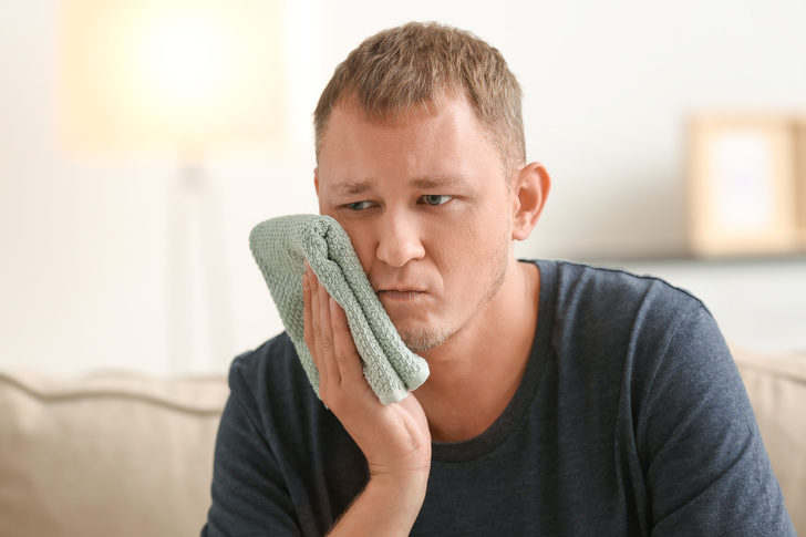 man-suffering-from-toothache-at-home-2