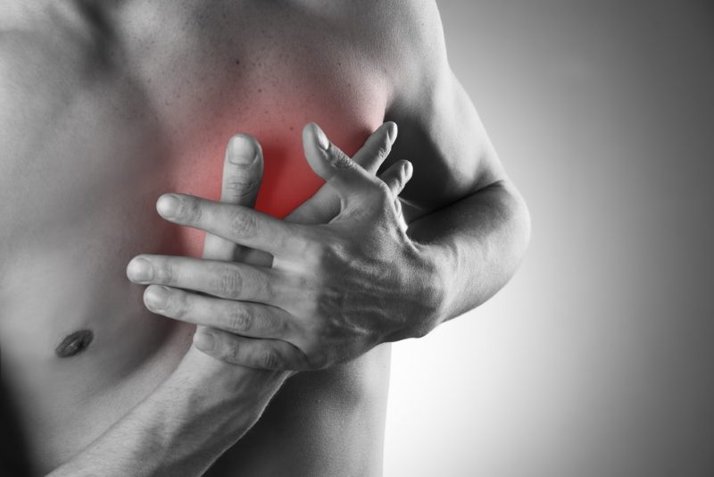 heart-attack-pain-in-the-human-body-black-and-white-photo-with-red-dot-2