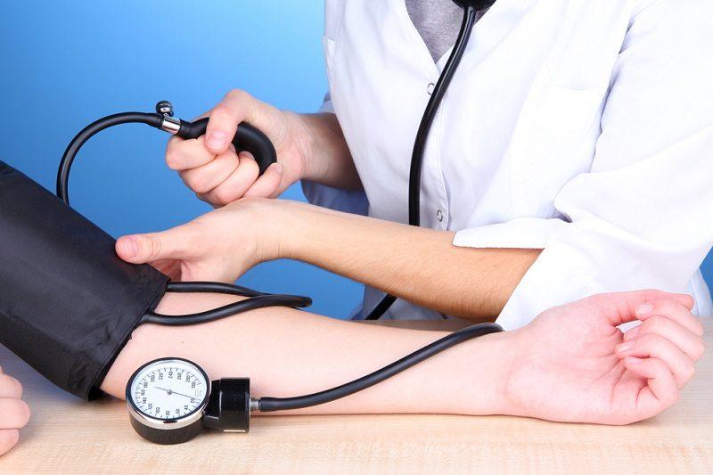 blood-pressure-measuring-on-blue-background