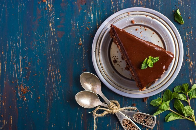 piece-of-chocolate-cake-with-mint-leaves-top-view